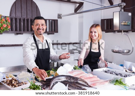 happy sellers at the store fresh fish - stock photo