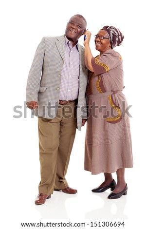 happy senior african couple using mobile phone isolated on white background - stock photo