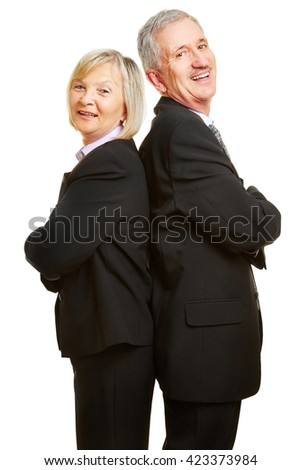 Happy senior couple as businesspeople leaning back to back with their arms crossed - stock photo