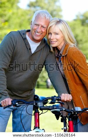 Happy senior couple cyclist. Healthy lifestile. - stock photo