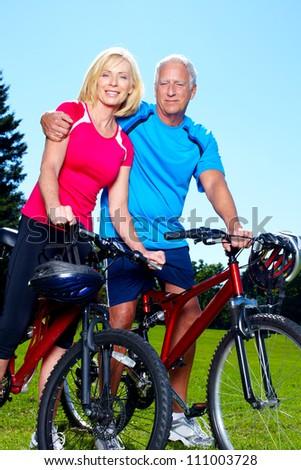 Happy senior couple cyclist. Healthy lifestyle. - stock photo
