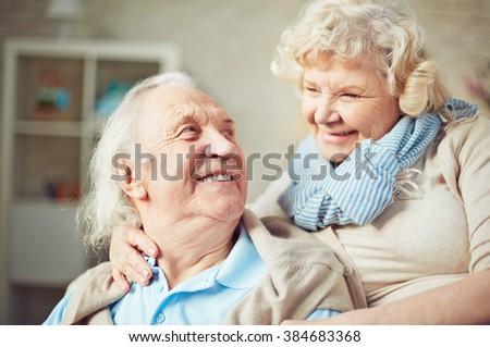 Happy senior couple embracing - stock photo