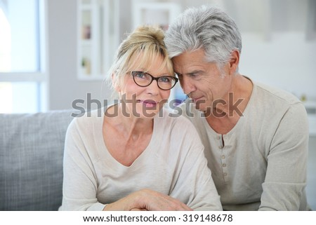 Happy senior couple embracing each other - stock photo