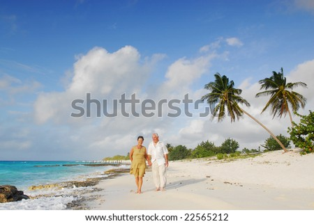 Happy senior couple enjoying retirement on tropical destination: Maria la Gorda beach on caribbean island Cuba - stock photo