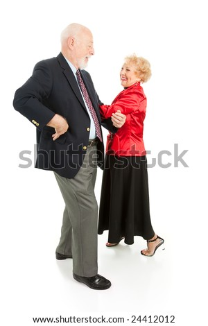 Happy senior couple having a great time square dancing.  Isolated on white. - stock photo