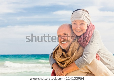 happy senior couple hugging enjoying retirement - stock photo