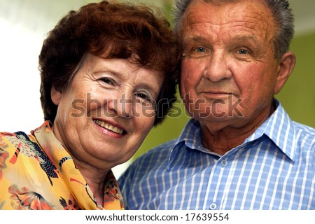 Happy senior couple in home - stock photo