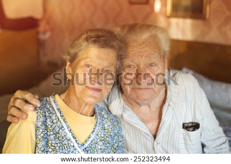 Happy senior couple in love inside of their house