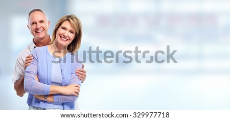 Happy senior couple in love over blue banner background. - stock photo
