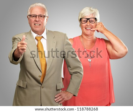 Happy Senior Couple Isolated On Gray Background - stock photo