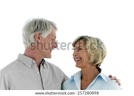 Happy senior couple looking at each other - stock photo