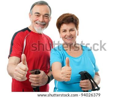 happy senior couple showing thumbs up isolated on white - stock photo