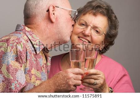 Happy Senior Couple toasting with Champagne glasses. - stock photo