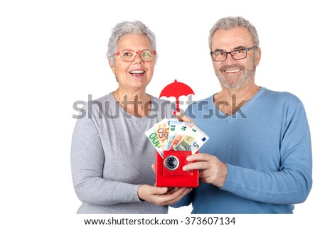 happy Senior couple with Euro money in red safe and paper umbrella looking up in excitement, isolated on white background - stock photo