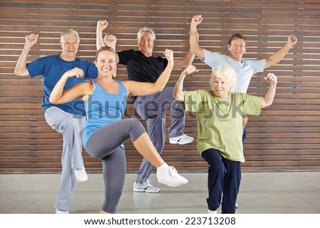 Happy senior group doing a bokwa class in gym - stock photo