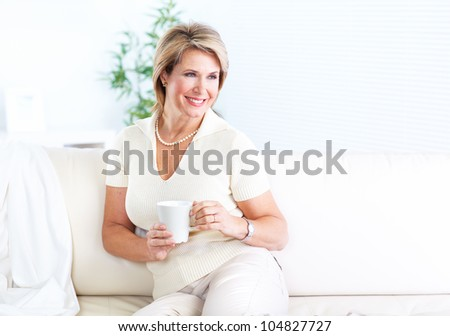 Happy senior healthy woman relaxing at home.