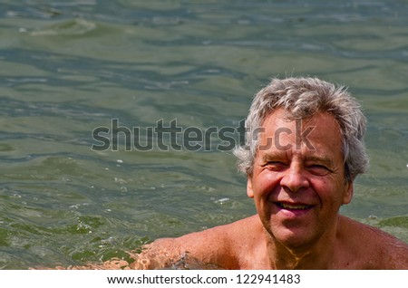 Happy senior in the water