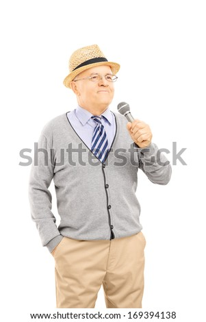 Happy senior man holding a microphone, isolated on white background - stock photo