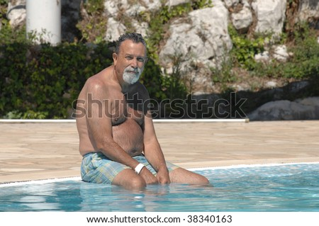 happy senior man in the swimming pool