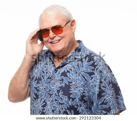 Happy senior man on cell phone looking at camera on white background. - stock photo