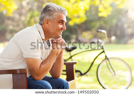 happy senior man relaxing at the park - stock photo