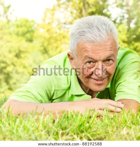 Happy senior man relaxing outdoors. - stock photo
