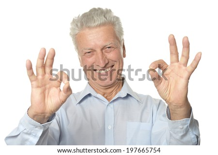 Happy senior man showing ok isolated on white background