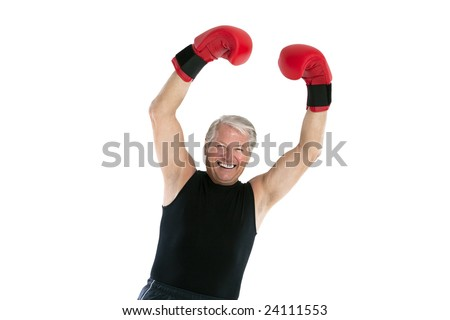 happy senior man with red boxing gloves
