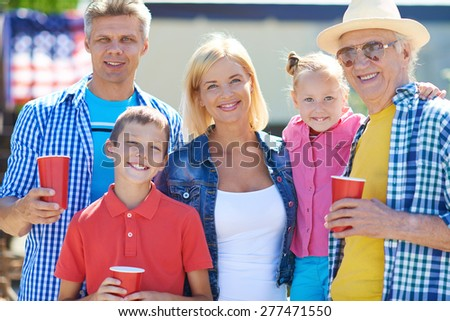 Happy senior man, young couple and kids enjoying weekend outside  - stock photo