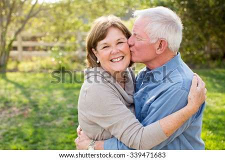 Happy senior mature couple in love outside in nature