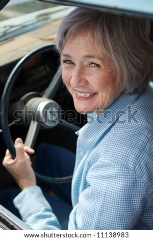 Happy senior out for a drive. - stock photo