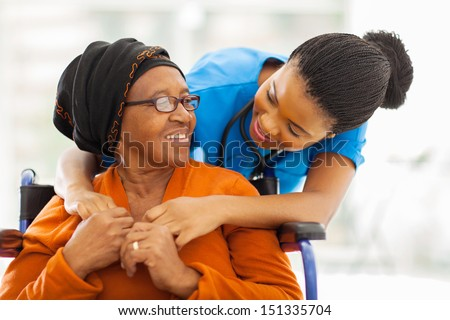 happy senior patient with friendly female nurse - stock photo