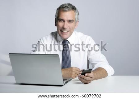 happy senior smiling businessman laptop computer mobile phone portrait - stock photo