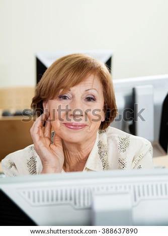 Happy Senior Woman In Computer Class - stock photo