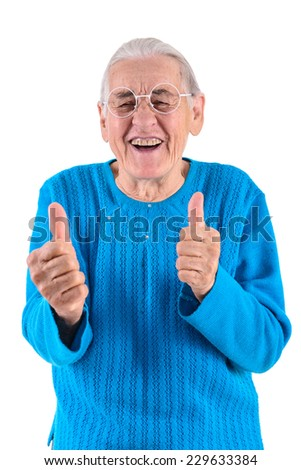 happy senior woman in glasses thumbs up.portrait isolated on white background - stock photo