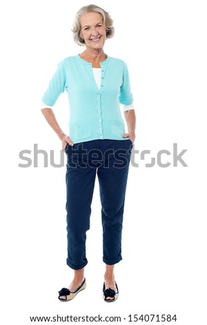 Happy senior woman isolated over white background - stock photo