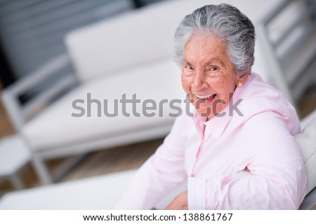 Happy senior woman relaxing at home and smiling