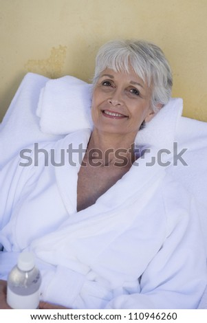 Happy senior woman relaxing in a spa - stock photo