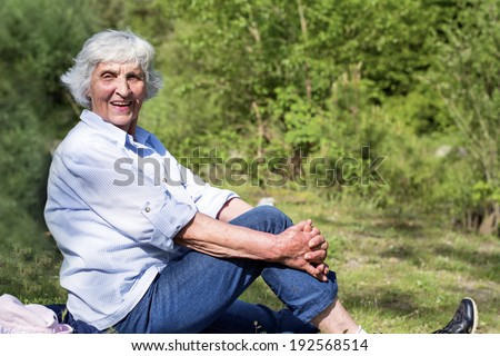happy senior woman resting in the mountain