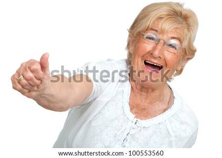 Happy senior woman showing thumbs up.Isolated on white. - stock photo