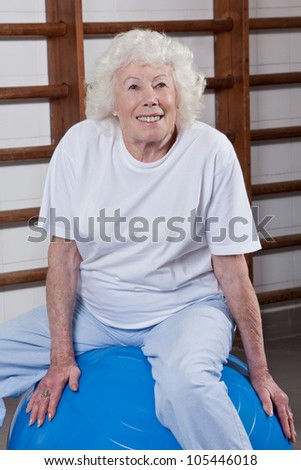 Happy Senior woman sits on a fitball. - stock photo