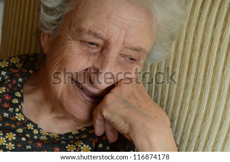 happy senior woman thinking / daydreaming - stock photo