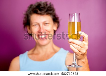 Happy senior woman toasting with champagne flute