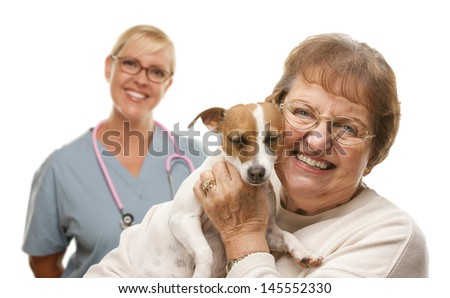 Happy Senior Woman with Her Dog and Veterinarian Behind Isolated on a White Background. - stock photo