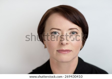 Happy senior woman with perfect anti-age make up, no wrinkles, not tired eyes, slight smile, relaxed face, take care, in-law, mother-in-law. Photo is good for social advertisement about family love. - stock photo