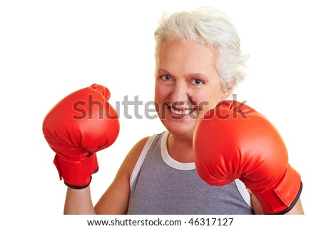 Happy senior woman with red boxing gloves