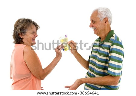 Happy Seniors couple holding together euro currency . - stock photo