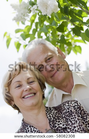 Happy seniors in a blossoming garden