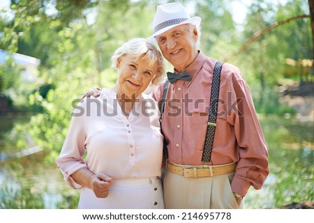 Happy seniors in smart casual enjoying summer rest - stock photo