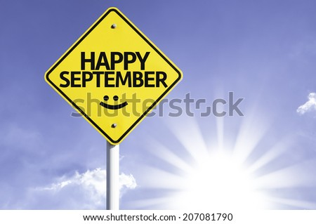 Happy September road sign with sun background  - stock photo